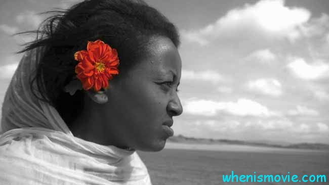 Beti with a red flower