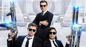 Liam Neeson, Chris Hemsworth, and Tessa Thompson in Men in Black: International